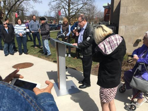 City Councillor Keith RIel reading the Proclamation
