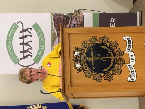 Marion Burton at the podium