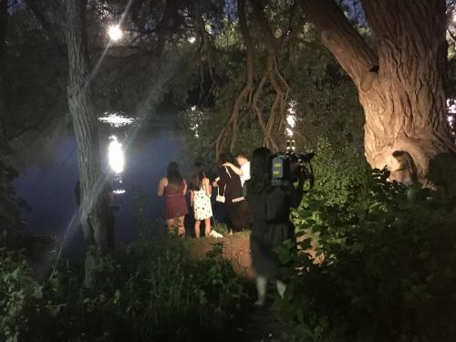 CHEX filming GE family tossing rose petals into the Otonobee river