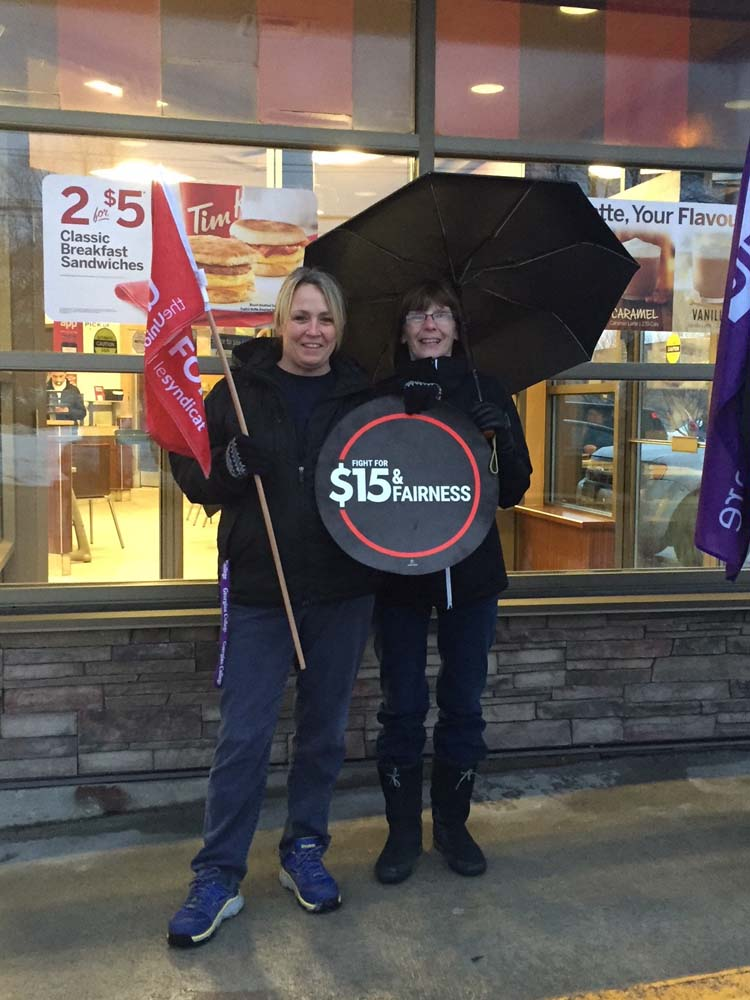 Unifor members rally for Tim Hortons workers
